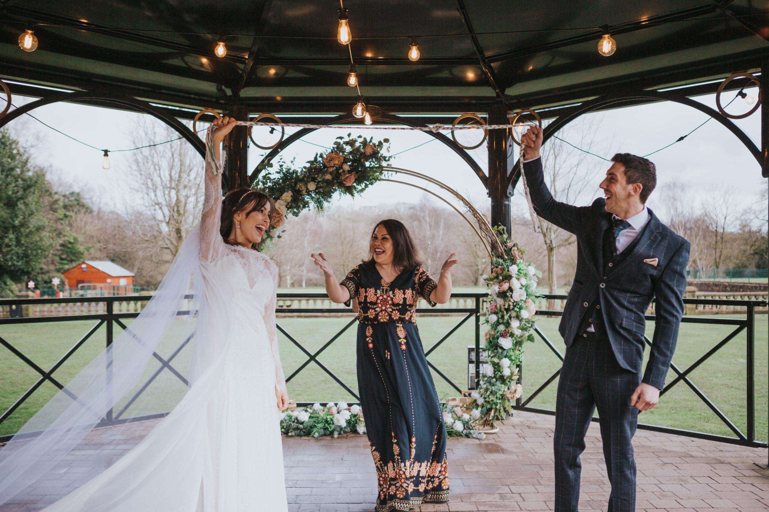 Independent wedding celebrant with bride & groom