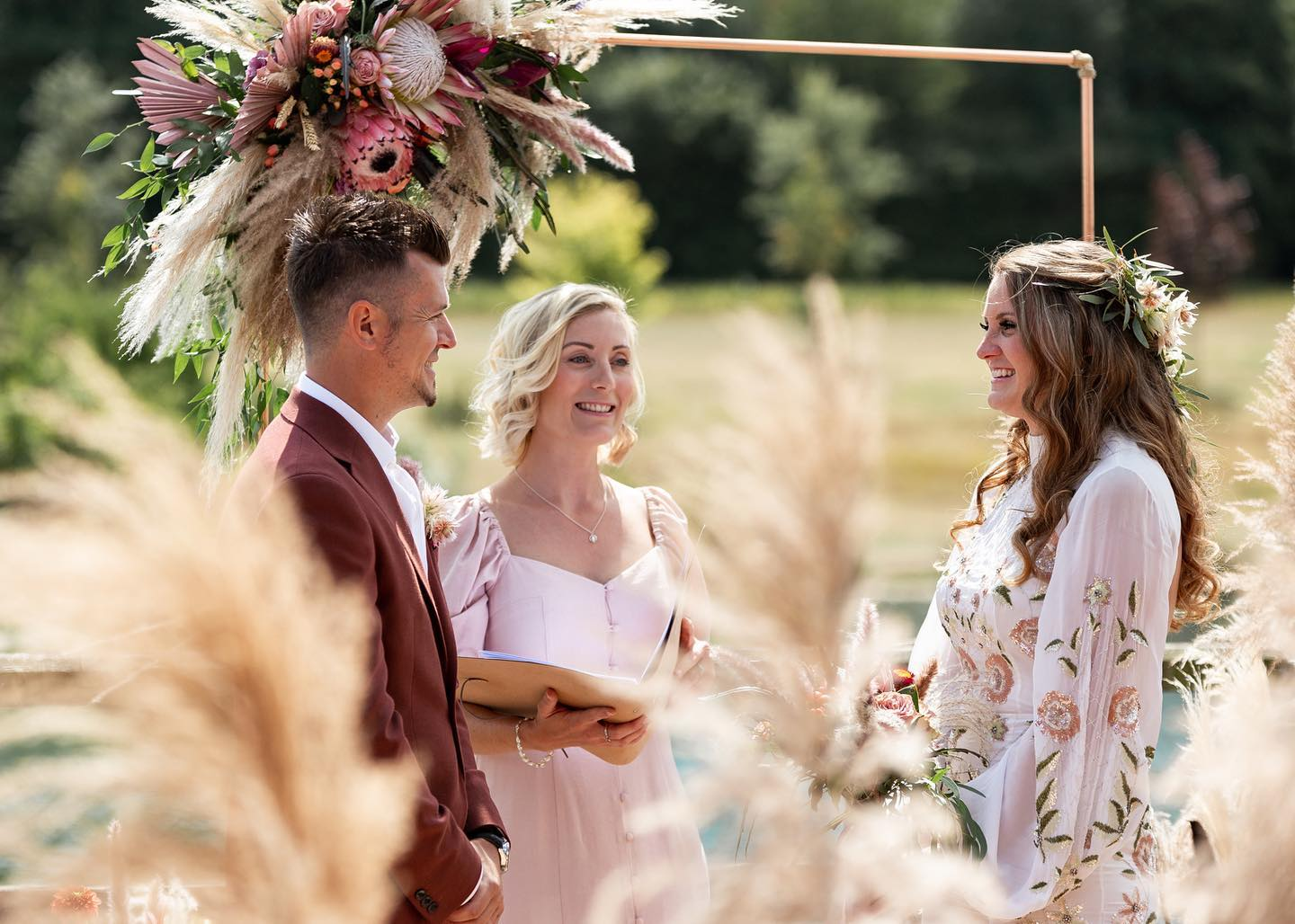 Independent Celebrant conducts outdoor wedding